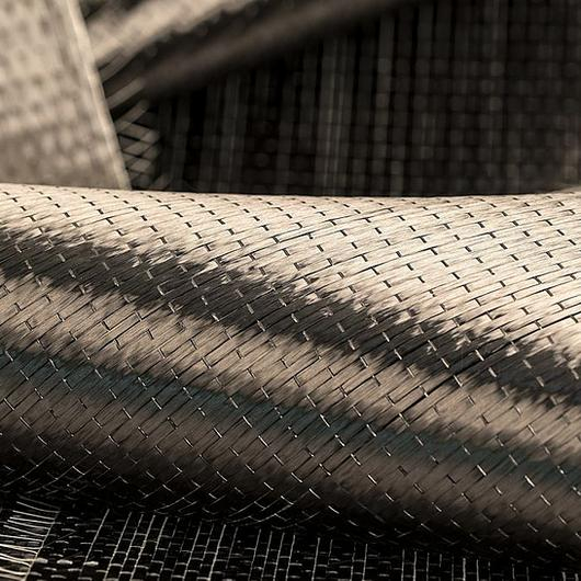 Structural strengthening with CFRP plates and FRP fabrics