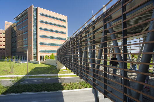 San Antonio Military Medical Center located in San Antonio, TX. 130,000 linear feet of TerraClad™ ceramic sunshade system used on hospital addition, parking garage and elevated walkway in two colors and two sizes.