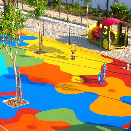 Pavimentos elásticos de caucho para Parques Infantiles