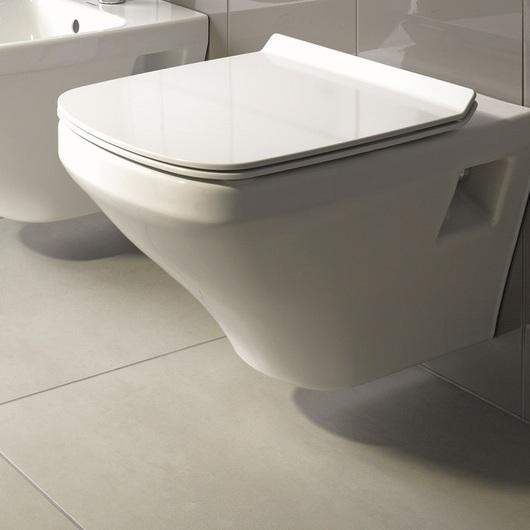 WC suspendido de Duravit con cisterna empotrada de Schell, con y sin sensor electrónico