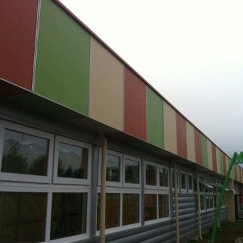 Revestimiento Fibrocemento alta densidad Pictura, en Jardín Infantil Girasol, Punta Arenas / Pizarreño