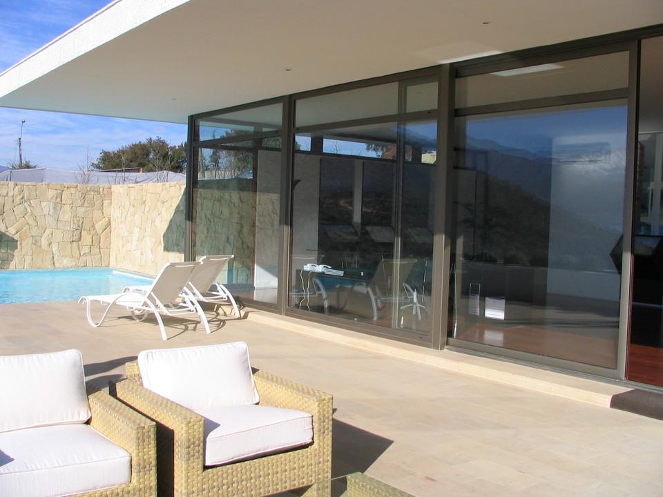 Ventanas y puertas de aluminio madera de glasstech for Cuanto cuesta el aluminio para ventanas