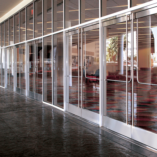 All-Glass Entrances Featuring DRS Wedge-Lock Door Rail System / C.R. Laurence