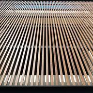 Celosías fijas y móviles de madera acetilada
