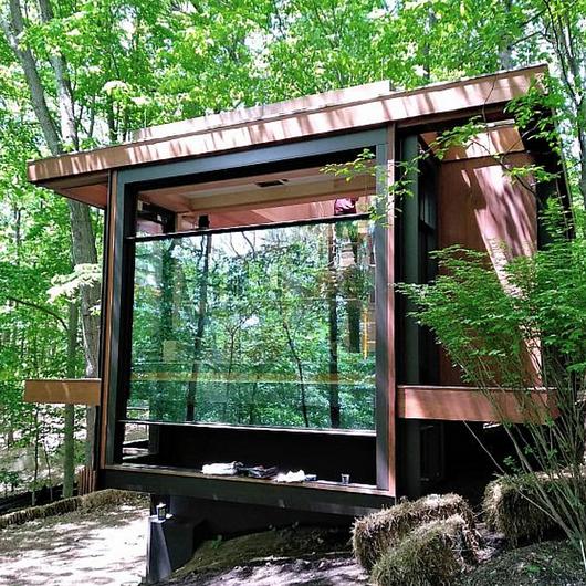 Guillotine Windows in Wooden Cabin / Libart