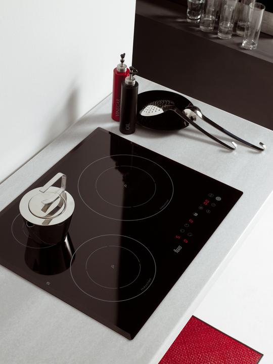 Cocinas vitrocer micas por inducci n de teka for Cocinas vitroceramicas