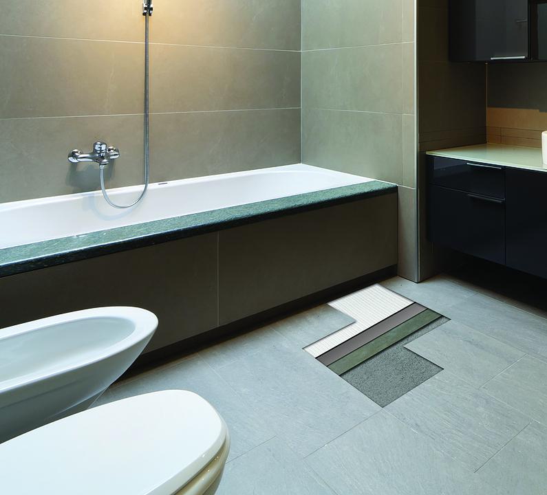 Cómo instalar porcelanato y mosaico de vidrio en baños y áreas húmedas