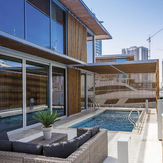 Lunawood Thermowood Façade in Marasi Water Homes in Dubai / Lunawood