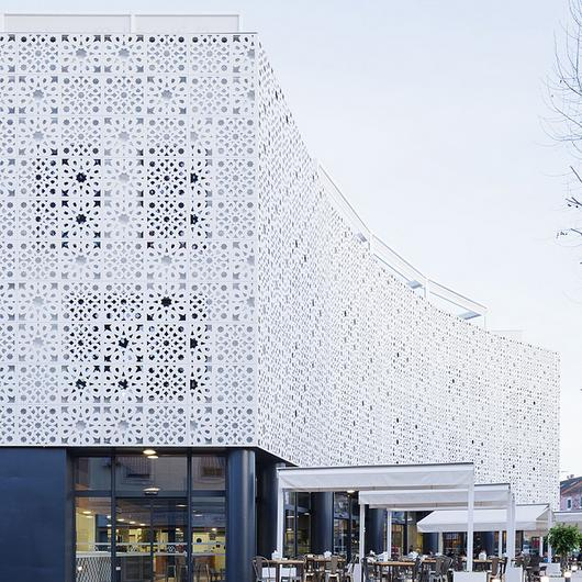 Perforated Facade Panel  in La Alquería Market / ULMA Architectural Solutions