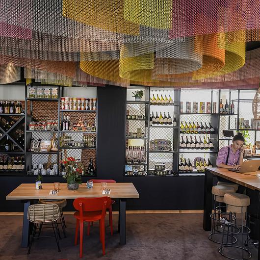Metal Fabric Ceiling Solution and Space Divider in Novotel Dijon Hotel / Kriskadecor