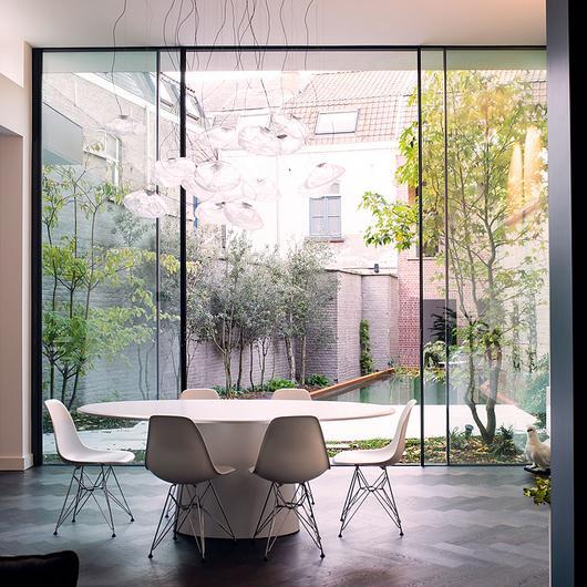 Sliding Window in Claeys Residence / Orama Minimal Frames